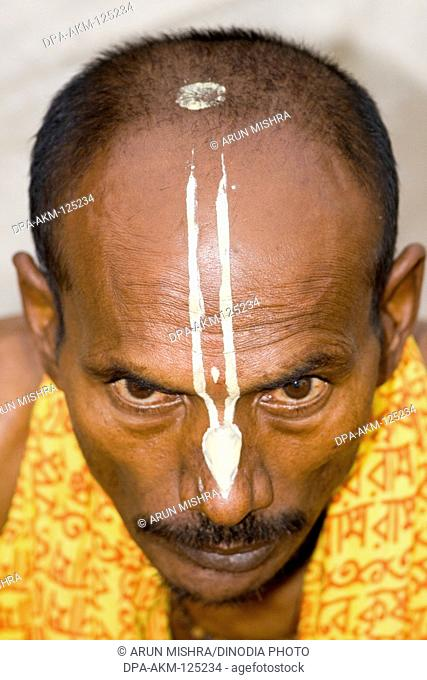 White tilak on forehead of Hindu saint in Varanasi on Ganga river ; Uttar Pradesh ; India