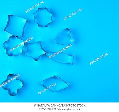 metal baking dish of cookies on a blue background, copy space