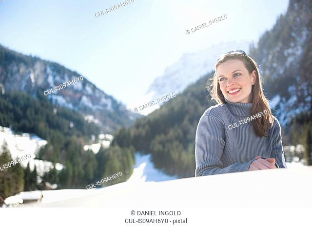Portrait of young woman on road trip, Bludenz, Austria