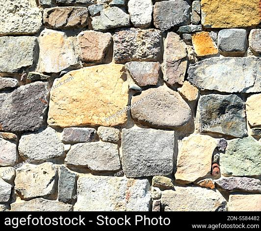 Background of stone wall texture photo. Close-up