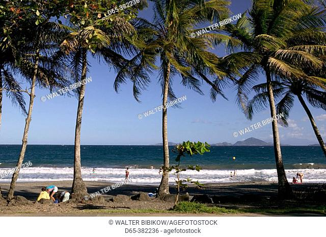 French West Indies (FWI), Guadeloupe, Basse-Terre, Trois-Rivieres: La Grande Anse, Black Sand Beach overlooking Les Saintes Islands (NR)