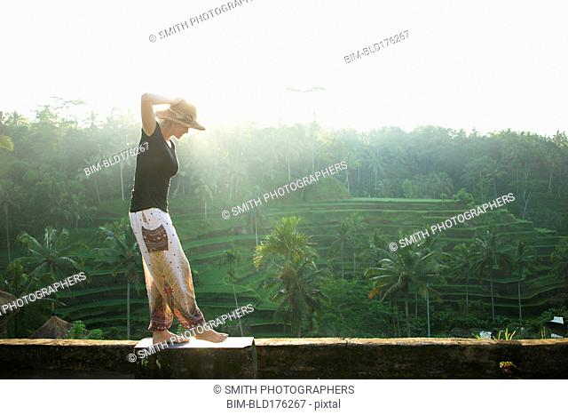 Caucasian tourist over rural rice terrace, Ubud, Bali, Indonesia