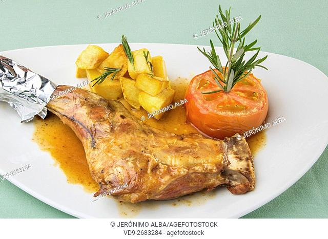 Leg of milk-fed lamb with roasted tomato and chips