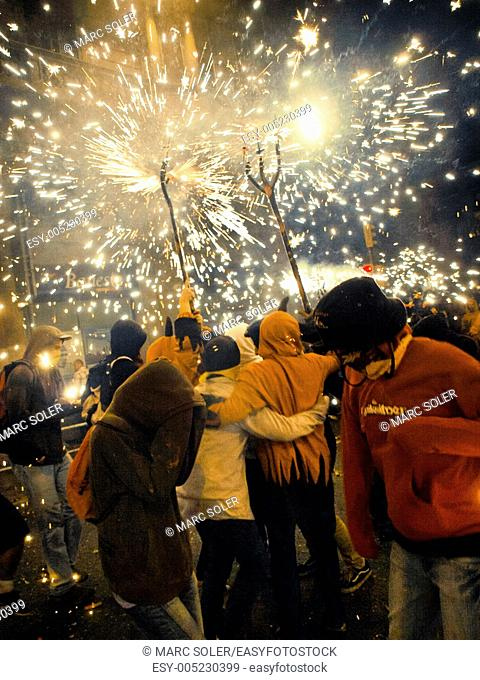 Correfoc. People dancing in the fire and sparks of demons. Festival in Barcelona, La Mercè. Catalonia, Spain