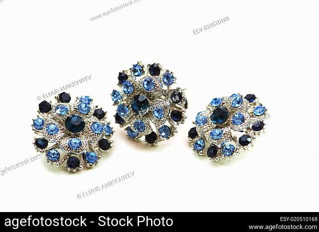 Earrings and ring isolated on the white background