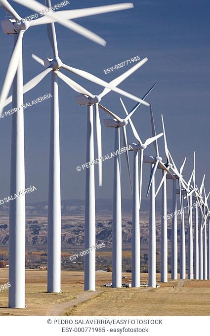 group of aligned windmills in Pozuelo de Aragon, Saragossa, Aragon, Spain