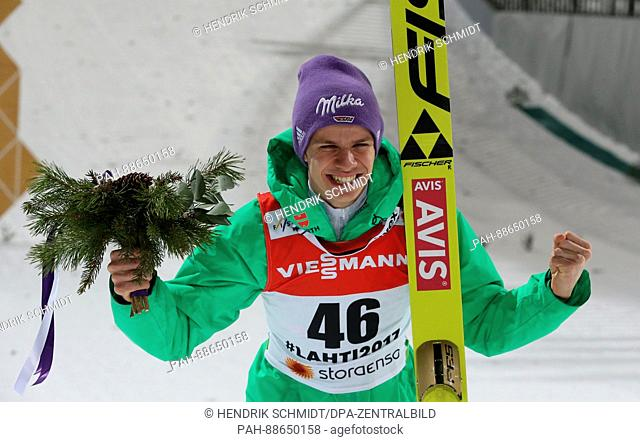 Andreas Wellinger from Germany (2nd place) celebrates after the men's large hill event at the Nordic Ski World Championship in Lahti, Finland, 2 March 2017