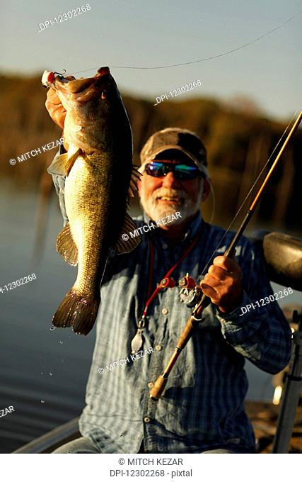 Bass Fisherman Lips Fish After Catching It