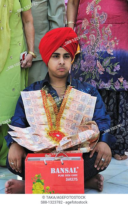 Young holly man in the Golden Temple, Punjab Amritsar India