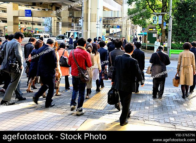 People crossing the street, Hakozaki junction near Tokyo City Terminal , Nihonbashi-Hakozaki-cho, Chuo-ku, Tokyo, Japan