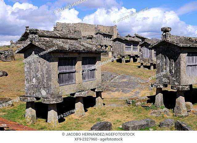 Espigueiros(traditional granary) and castle.Lindoso.Peneda-Gerês National Park.Minho region.Portugal