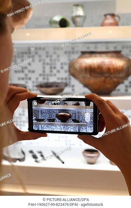 """24 June 2019, Baden-Wuerttemberg, Karlsruhe: A user of the exhibition """"""""Archaeology in Baden - Expothek¹"""""""" conducts an object search with an exponent in the..."""