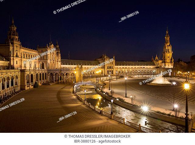 The illuminated Plaza de España at dusk, Seville, Seville province, Andalusia, Spain