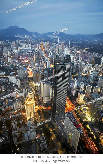 Aerial city view from the top of KK100 (Kingkey 100) skyscraper at dusk. Luohu District, Shenzhen, Guangdong Province, China