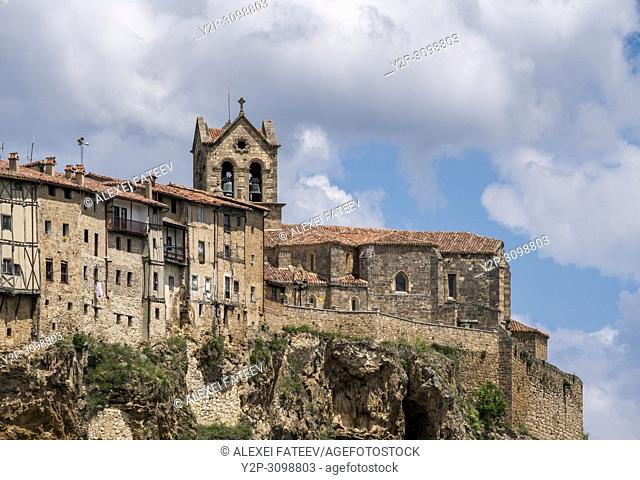 Hanging houses and church of St. Vicente in Frías, province of Burgos, Castile and Leon, Spain