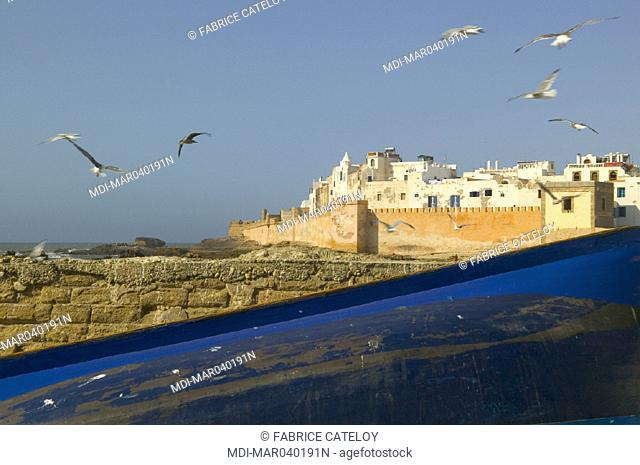 Fishing boats in the foreground and Essaouira in the background