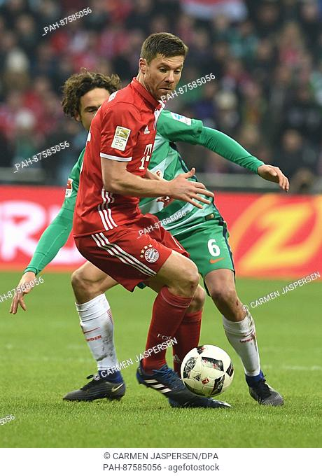 Munich's Xabi Alonso and Bremen's Thomas Delaney fight for the ball during the German Bundesliga soccer match between Werder Bremen and Bayern Munich at the...