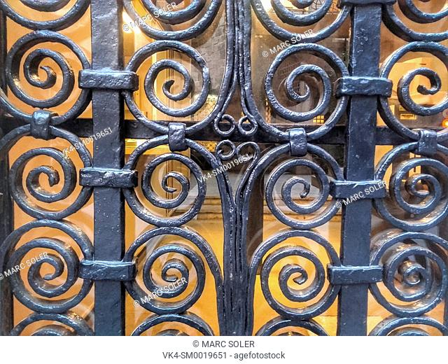 A decorative metal door