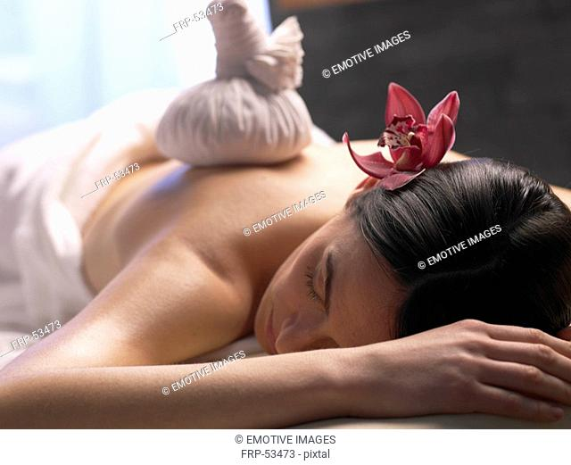 Woman getting a massage with a compress