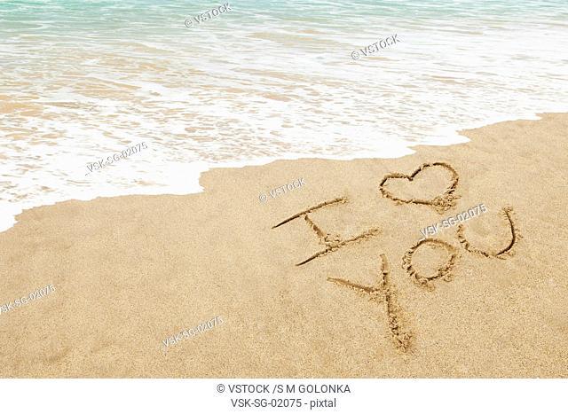 USA, California, Hermosa Beach, I love you written in sand on beach