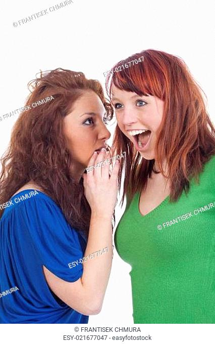 women whispering gossip