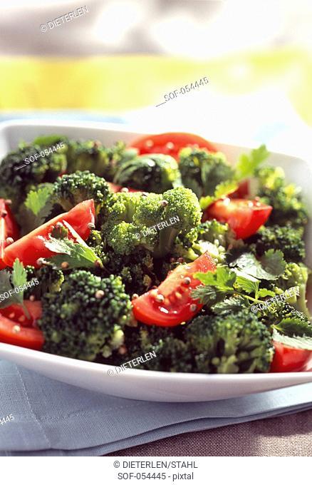 tomato, broccoli and two coriander salad