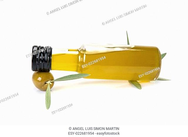 Oil bottle resting on an olive