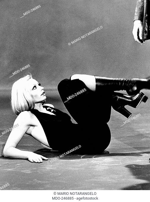 Raffaella Carrà rehearsing a choreography. Dancer and presenter Raffaella Carrà on the floor wearing a dress showing her shoulders during the rehearsal of a...