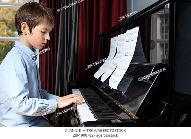 Boy plays the piano