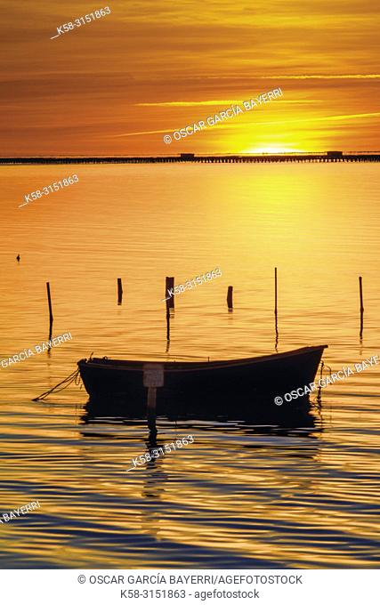 Boat at dawn. Delta del Ebro, Tarragona Province, Catalonia, Spain.Province, Catalonia, Spain