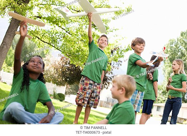 Group of children playing with toy airplanes