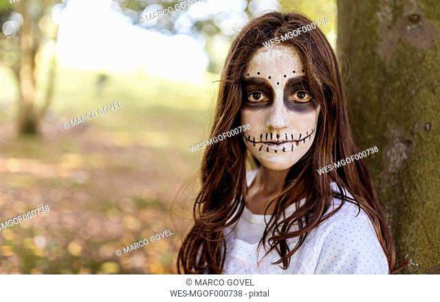 Portrait of masquerade girl at Halloween