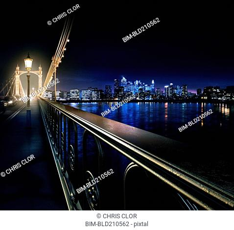 Railing on urban bridge at night, London, United Kingdom