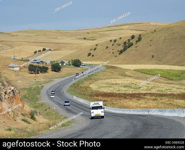 Road between Osh and Jalal-Abad (Dzhalal-Abad, Djalal-Abat, Jalalabat) in the Fergana Valley close to the border to Uzbekistan
