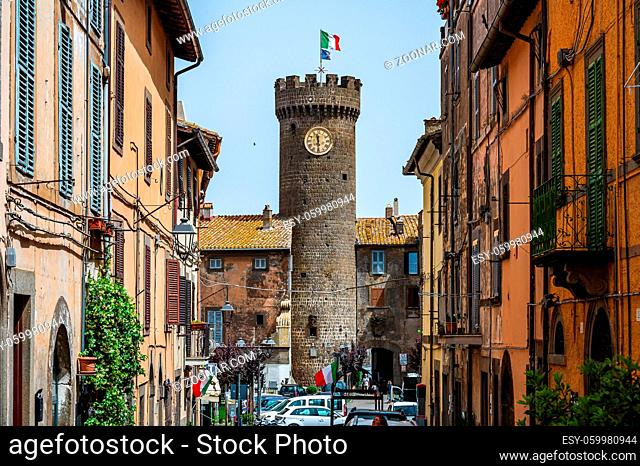 Clock tower at the gate, entering the old town of Bagnaia, in Tuscia