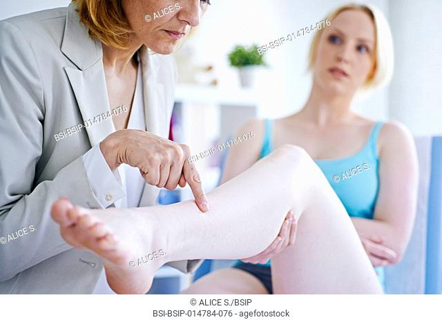 Doctor examining a patient's leg