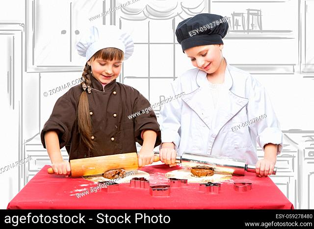 Beautiful boy and girl in chef clothes making christmas cookies with plunger. Children over kitchen drawing background