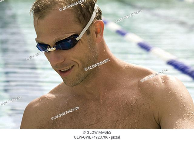 Close-up of a mid adult man wearing swimming goggles