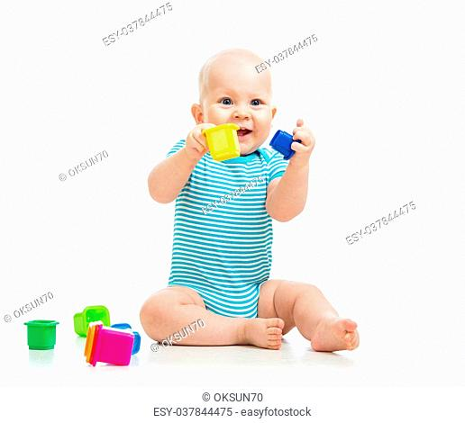 Cute little child is playing with toys isolated over white