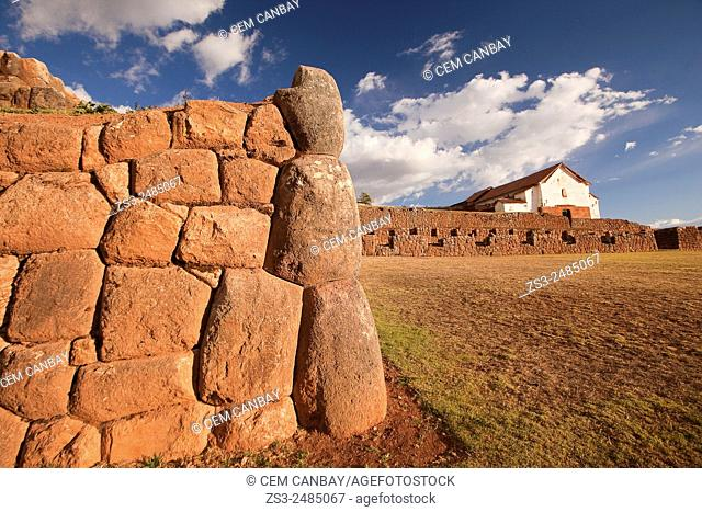 Ancient Inca walls at Chinchero ruins with the colonial church at the background, Chinchero, Valle Sagrado, Cuzco, Peru, South America