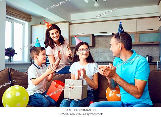 Happy family with cake on birthday party