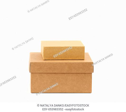 two brown cardboard boxes on a white background, close up