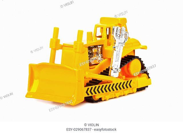 Toy bulldozer isolated on white background