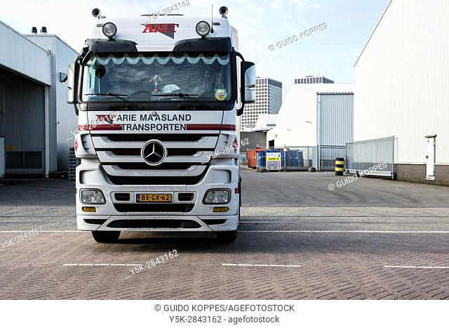 Rotterdam, Netherlands. Truck leaving harbour warehouse after unloading cargo, bound for export and shipment