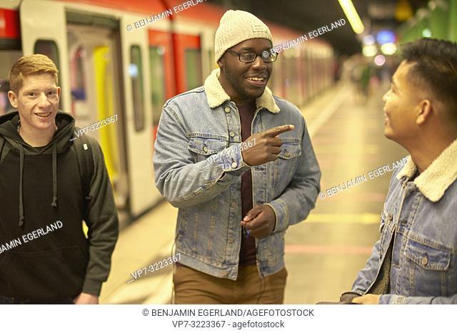 friends in underground train station, public transportation