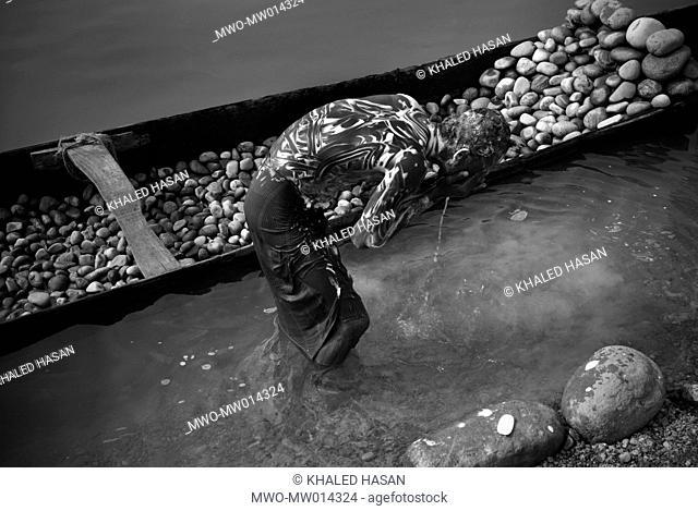 A stone collector bathing at the bank of Piyain river after work Jaflong, Sylhet, Bangladesh January 13, 2008