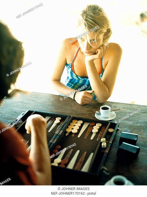 A young woman playing backgammon