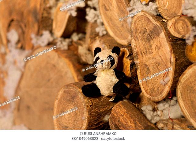 panda bear Christmas tree toy wodden detalis blue bokeh