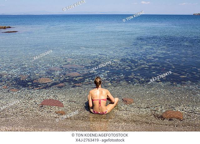 woman is sunbathing in Levbos, Greece