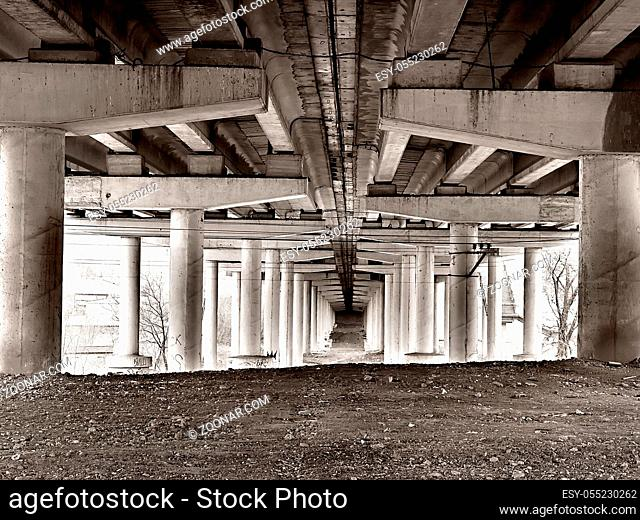 bottom view of a concrete bridge in grunge style